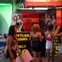 """The term Go-Go derives from the phrase """"go-go-go"""" for a high-energy person, and was influenced by the French expression à gogo, meaning """"in abundance, galore""""<br />Go Go bars originally from New York are now popularised by the strip clubs in Bangkok & Pattaya. Now also known as PatPong bars due to their abundance in Patpong in Bangkok, they are predominantly centres of the sex trade that has popularised Thailand."""
